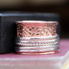 Copper and Sterling Silver Spinner Ring, Mixed Metal Ring, Handmade, Made To Order by LoreleyJewelry on Etsy https://www.etsy.com/listing/63017041/copper-and-sterling-silver-spinner-ring