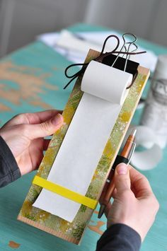 DIY tutorial for a handy notepad .. using adding machine rolls.  Oh heavens. I have a CASE of those things!  Who uses adding machines these days?  bbwwahaha