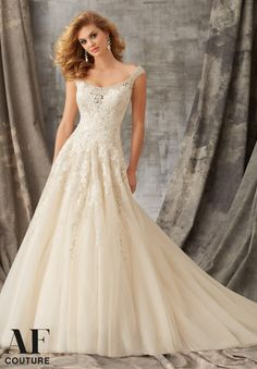 Bridal Gown 1351 Crystal Beaded Embroidery and Venice Lace Decorate the Tulle Ball Gown