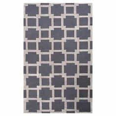 Adorned with an overlapping squares motif, this artfully hand-tufted rug offers bold geometric style to your floors.   Product: RugConstruction Material: 100% PolyesterColor: Gray and ivoryFeatures:  Hand-tuftedLooped and cutLustrous finish  Note: Please be aware that actual colors may vary from those shown on your screen. Accent rugs may also not show the entire pattern that the corresponding area rugs have.Cleaning and Care: Vacuum regularly and spot clean