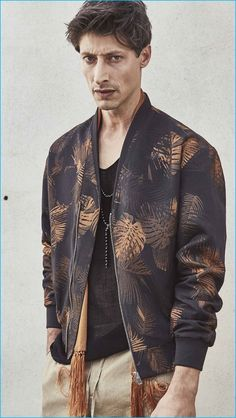 Model Jason Mason dons a patterned bomber jacket from The Kooples' spring-summer 2017 men's collection.