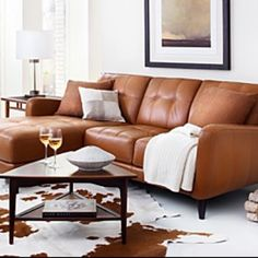 Burnt orange. Leather couch. Looks cozy.