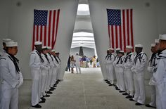 121207-N-RI884-218 PEARL HARBOR (Dec. 07, 2012) U.S. Navy Sailors join other members of the U.S. military, National Park Service and guests during the interment of Seaman 1st Class Wallace F. Quillin at the USS Arizona Memorial on Joint Base Pearl Harbor-Hickam. The guests included Pearl Harbor survivors and other veterans at the National Park Service and U.S. Navy-hosted joint memorial ceremony. (U.S. Navy photo by Mass Communication Specialist 2nd Class Daniel Barker/Released)