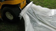 tarp tow uses a clamp and roll type system to hold any material