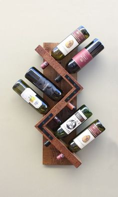Our meticulously handmade wine rack was designed to create an awe-inspiring focal point for your favorite wines that's both functional and artistic.