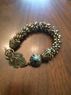 Here's a kumihimo bracelet I just finished.  I made the lampwork bead.