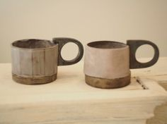 Kazuhiro Katase // Two beautiful ceramic mugs in muted pink and purple colors. Check out that interesting chunky handle!
