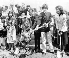 June 12, 1977: Three generations of Kennedys dug small scoops of muddy soil during groundbreaking ceremonies for the John F. Kennedy Library construction at the University of Massachusetts Harbor Campus. From left, Caroline Kennedy, Rose Kennedy, Senator Edward M. Kennedy, John Kennedy Jr., and Jacqueline Kennedy Onassis did the ceremonial honors.