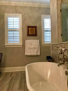 Beautiful bathroom with our custom Louverwood shutters on the windows. They are perfect for humid rooms and add to the energy efficiency of your windows. Bathroom Window Coverings, Bathroom Windows, Interior And Exterior Angles, Attic Bedrooms, Shades Blinds, Bathroom Interior Design, Beautiful Bathrooms, Corner Bathtub, Shutters
