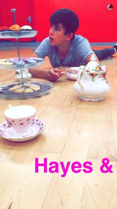 hayes grier at a tea party with emma slater