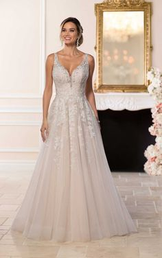 Romantic and just a little bit sexy, this designer wedding dress from Stella York is a glittery gem with layered beaded lace!