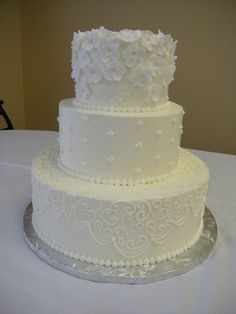 Pretty cake. Love the simple white with all the different details