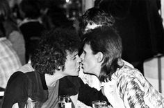 Lou Reed & David Bowie lean in for a kiss.