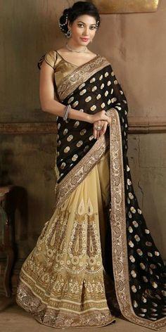 Exquisite Fancy Pallu Saree in Black And Beige Color.
