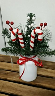 Candy cane mason jar arrangement.  Stocking stuffer.   Check out this item in my Etsy shop https://www.etsy.com/listing/258558026/mason-jar-candy-cane-arrangement