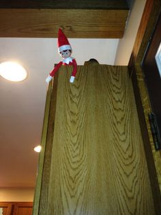 Elfie Day 20 - checking out all the presents under the tree at the cabin