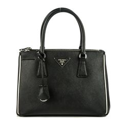 This is an authentic PRADA Saffiano Lux Galleria Small Double Zip Tote in Nero Black and Talco.  This chic tote is crafted of Saffiano cross-grain leather in black.  The bag features rolled leather top handles with polished brass links, an optional shoulder strap with brass claps, with a hanging clochette.  The top is open and features two full length side zippered compartments and a black Prada monogram jacquard interior.  This is a marvelous tote for everyday wear with the stylish…
