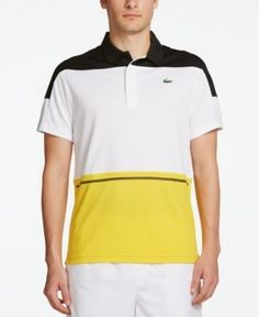 Constructed in a pique knit fabric that helps draw moisture away from your skin to help keep you cooler and drier, this colorblocked polo from Lacoste is a winning choice. | Polyester | Machine washab