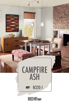 Looking for a versatile wall color that can work with a variety of interior design styles? Start with BEHR® Paint in Campfire Ash. Neutral paint colors are always in style, and we're loving the look of this light gray hue. Featured here in this dining room, click below for full color details.