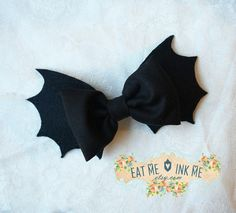 Super cute hair clip in the shape of bat wings, finished with black bow on top. Bow attaches with clip on the other side. Listing is for one