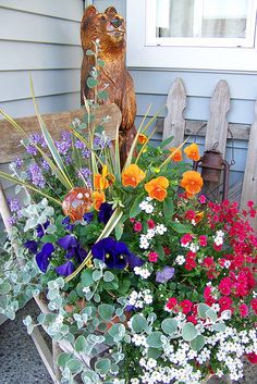 Front Porch With a lovely potted plant full of beautiful flowers.