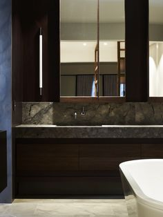 Luxurious bathroom with dark colour theme and marble stone countertop. Middle Park House, Melbourne by Kerry Phelan Design Office Chamberlain Javens Architects. #rassphome #modern