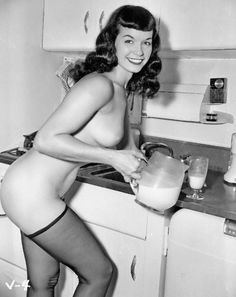 Bettie Page Pouring some batter