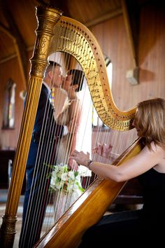Harpist and wedding couple. Very romantic! MistiMorningstar.com
