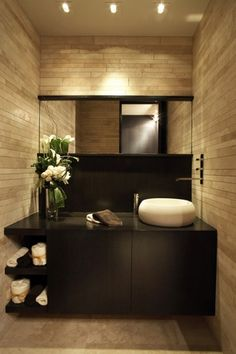 Now we're talking. Modern and warm. I appreciate a clean look and extreme cleanliness, I am so over sterile-white baths that look and feel cold.