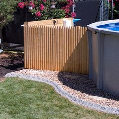 Above Ground Pool Edging Ideas image of green landscaping around above ground pool Use Stone Edge Decorative Edging For Around Your Above Ground Pool It Is Chlorine And