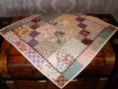 Vintage Autumn Table Topper - Spread a gorgeous color palette of charm pack quilt patterns across a table in any room of your house for a classic autumn look. This table topper quilt pattern has a rustic charm that's complementary to any kind of home decor.