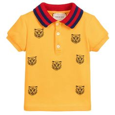 aad8971aae43 Baby boys yellow polo shirt with tiger embroidery from Gucci. Made in soft  cotton piqué