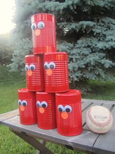 elmo party spray paint empty soup cans add googly eyes for a. Black Bedroom Furniture Sets. Home Design Ideas