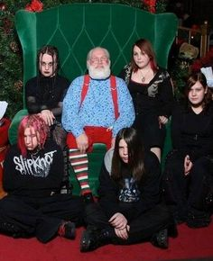 They all look like they are full of holiday cheer!! Santa looks slightly nervous!