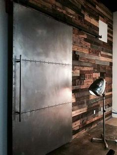 Love the contrast between the wood planked wall and the metal barn door