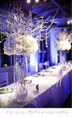 Love the frosted branches and crystals hanging and the ivory/white flowers maybe a different type of vase?