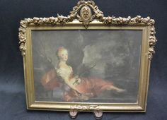 Wood and Gesso Picture Frame with Rococo print of Diana / Artemis, the goddess of the hunt The window is 9.75 x 13.75 The wooden molding is 12 x 16.5 The overall frame, with the gesso garland is 14.5 x 17 The frame is in good condition with some minor chipping to the gesso. Thanks for looking. WF Frame Gallery, Vintage Picture Frames, Artemis, Rococo, Garland, Diana, Window, Antiques, Wood