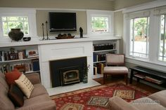 Original craftsman windows and cozy fireplace make this living room a favorite . TV above fireplace? Craftsman Windows, Craftsman Fireplace, Cottage Fireplace, Craftsman Interior, Cozy Fireplace, Fireplace Design, Modern Craftsman, Fireplace Ideas, Craftsman Style