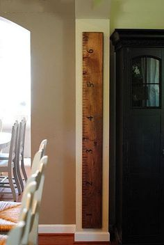 2 x 4 painted like a ruler ... great place to measure the kids as they grow.