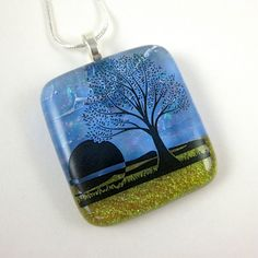Summer Sun Fused Glass Pendant    Transparent blue and shimmering gold dichroic glass create a stunning backdrop for this glass pendant.