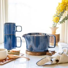 Afternoon tea. Hasami teapot + mugs, now in gloss blue / Shop now - link in profile #schoolhouseliving #schoolhouseelectric Very sweet and inviting look!
