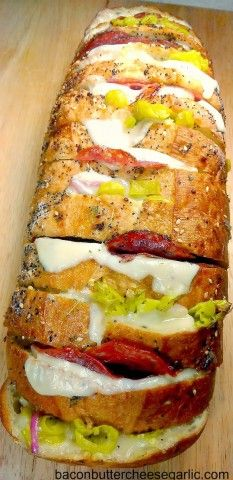 Italian Deli Crazy Bread ~ This Italian deli crazy bread is packed with such delectable components as spiced mayo, red onions, pepperoncini peppers, salami, and three different kinds of cheese.