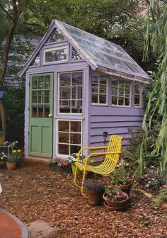 Potting Shed with Salvaged Parts - A whimsical backyard structure, this custom greenhouse is comprised of found windows of varying sizes. The solar-panel roof heats the interior, and a stained-glass w (Diy Garden Projects) Backyard Greenhouse, Small Greenhouse, Greenhouse Plans, Greenhouse Pictures, Greenhouse Wedding, Portable Greenhouse, Homemade Greenhouse, Old Window Greenhouse, Greenhouse Supplies