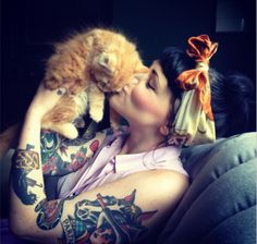 tattoos & kitty kisses.