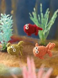 Knit this cute little goldfish that would be great to give as a gift and ideal for using up oddments of yarn. The pattern is suitable for knitters of all abilities. Knitted Animals, Goldfish, Knitting Patterns, Dinosaur Stuffed Animal, Creatures, Christmas Ornaments, Toys, Holiday Decor, Knits