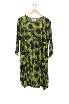 Product Description: Bold swirl print dress with pockets, 3/4 sleeve, slight gathered seam to waist and soft gathering at hemline. Sits at knee.  Fabric: 100% Viscose  Colour: Green, Black  Brand: Masai  Price:  £89.00  For assistance or any information about this item, please call one of our team on + 44 (0) 1424 272925