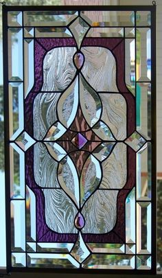 Simple leaded glass design, beautiful. Small window for narrow window seat.