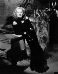 Marlene Dietrich, 1936, wearing a dress by Elsa Schiaparelli