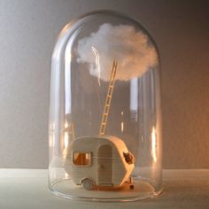 A series of mini sculptures in glass bells. Small worlds, conserved stories.