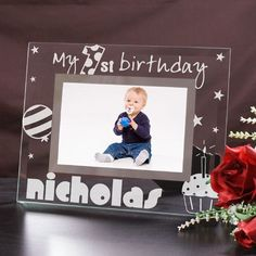 Baby First Birthday Engraved Glass Picture Frames. Give your favorite birthday boy or girl a unique gift they can cherish for a lifetime when you give this adorable Engraved 1st Birthday Picture Frame. This Engraved First Birthday Frame lets you capture any special moment from your child's birthday and becomes a treasured keepsake enjoyed year after year. Makes a unique gift idea from Mom, Dad, Grandma, Grandpa, Aunts and Uncles.